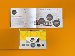 The MBS Group catalogue featured a pocket design in the back that held colorful location tabs and was die-cut to hold a small brochure insert.
