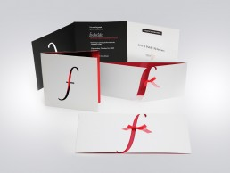 A die-cut f and a tiny red bow accented this unique invitation design for a lingerie event at Fredericks of Hollywood