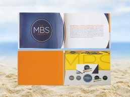 The MBS Group catalogue featured a pocket design in the back that held colorful location tabs and was die-cut to hold a small brochure insert